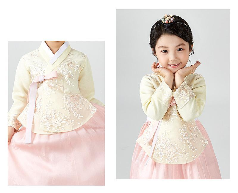 Young girl cute smile and wearing a girls korean hanbok with pastel yellow top and pink skirt