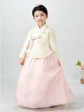 Young girl wearing a girls korean hanbok with pastel yellow top and pink skirt