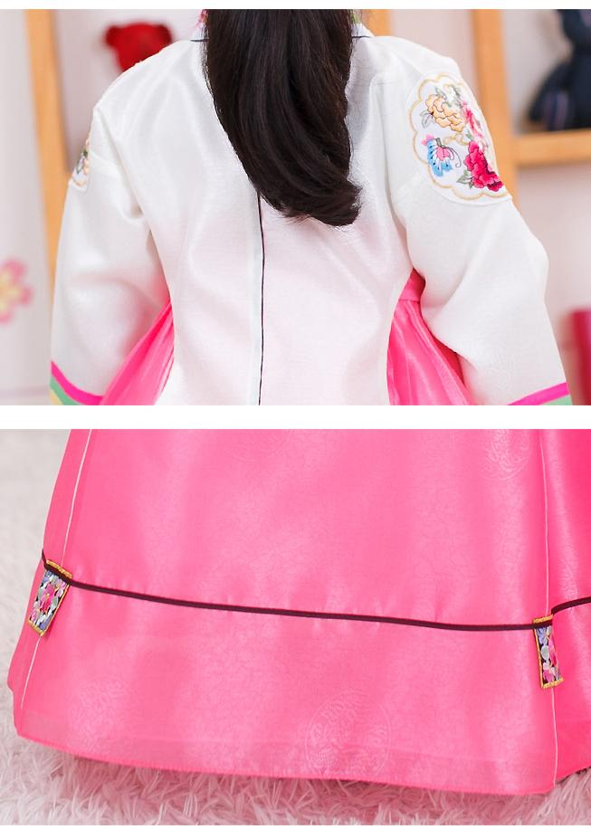 Closeup of girls korean hanbok with white top and red skirt