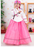 Young girl wearing a girls korean hanbok with white top and pink skirt