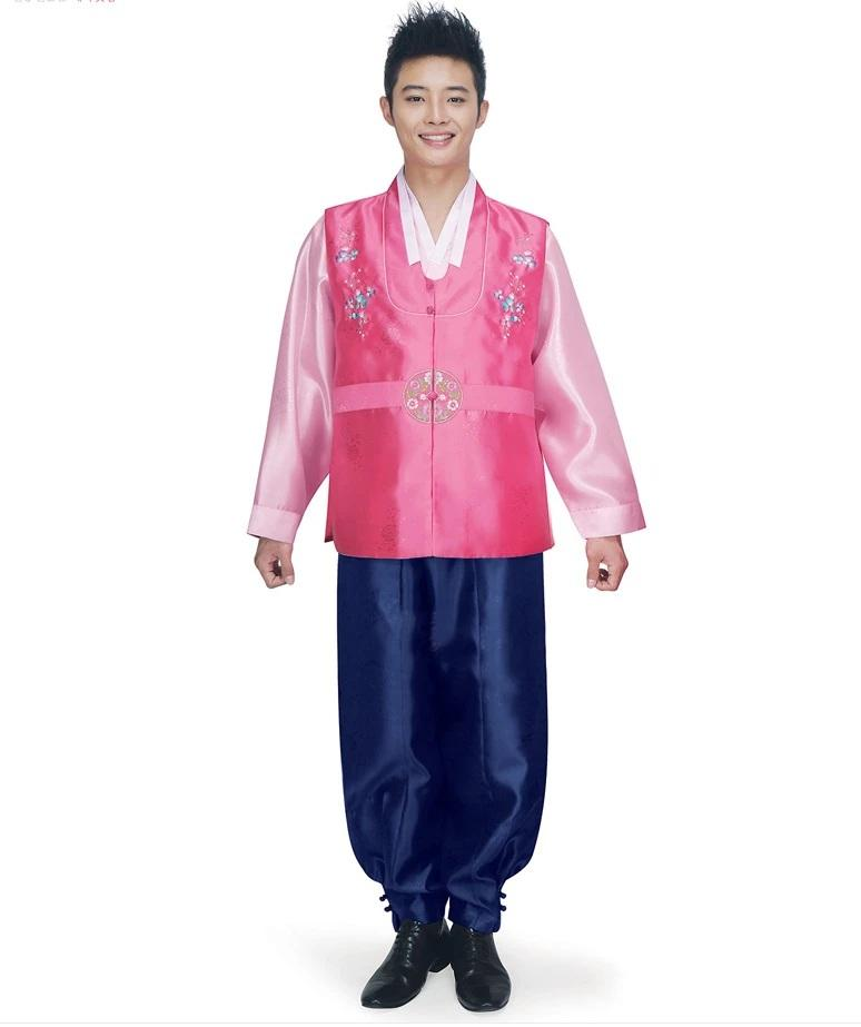 man wearing men's korean hanbok with pink top and navy pants