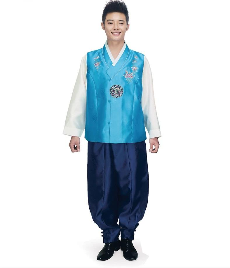 man wearing men's korean hanbok with blue top and navy pants