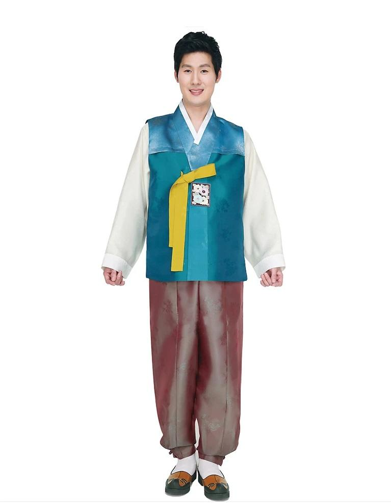 man wearing men's korean hanbok with teal top and brown pants