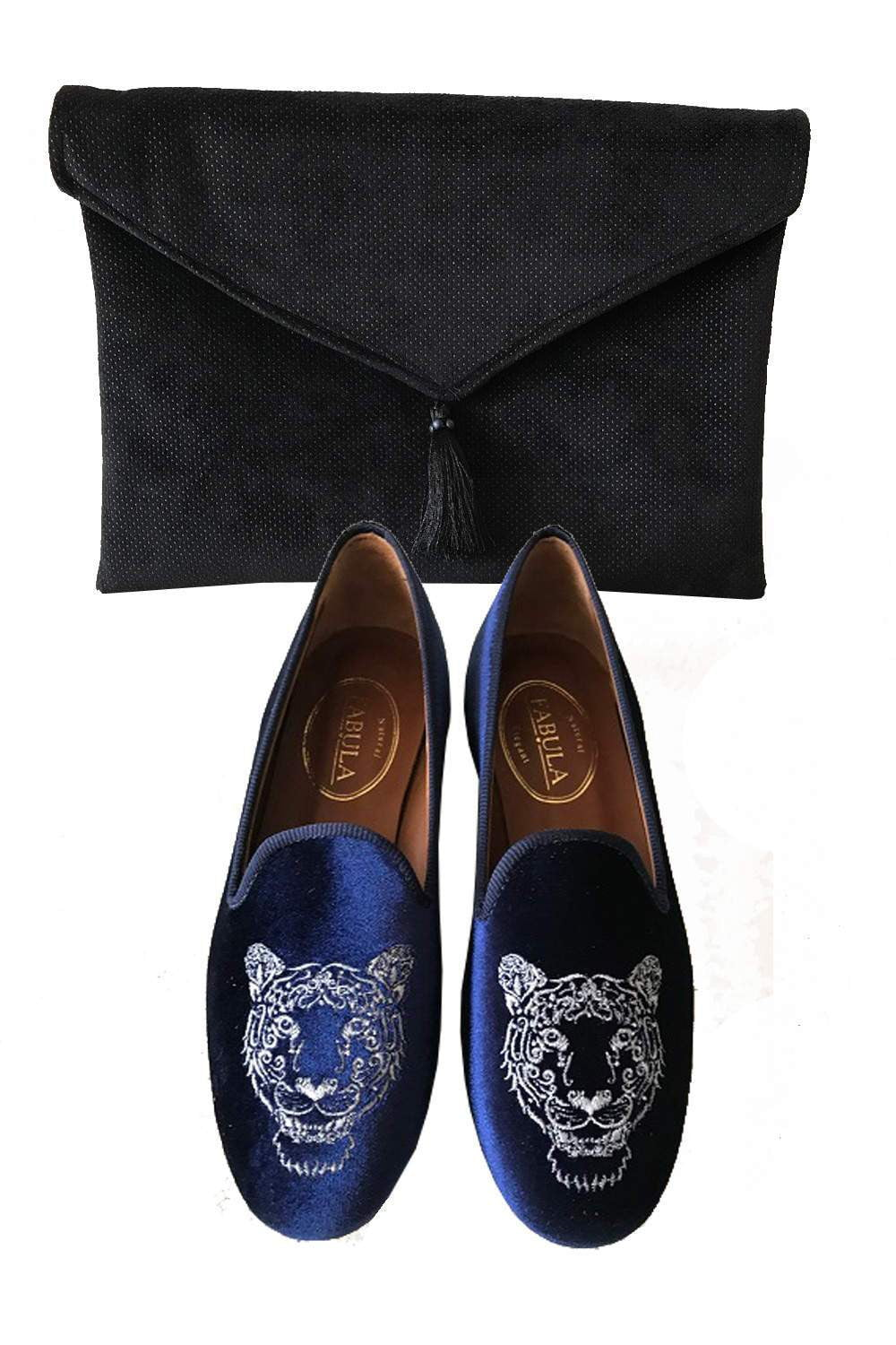 handmade navy slippers with a leon embroidery