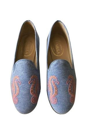 handmade blue linen slippers with an orange seahorse embroidery