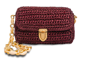 handmade burgundy crochet bag with a beige shoulder chain