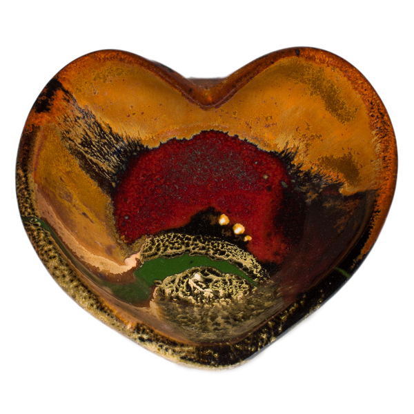 Heart-shaped bowl in earth tones and red.  Handmade pottery by Prairie Fire Pottery.  Hand made is stoneware clay in the U.S.A.  Overhead view.