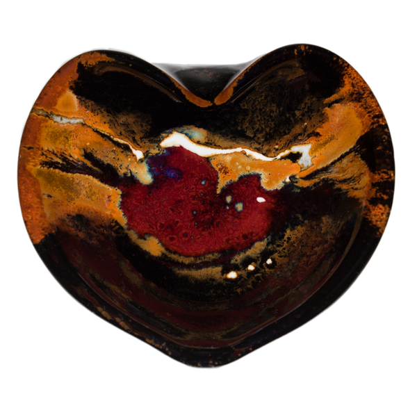 Heart-shaped bowl with red over toasted orange and black.  Handmade pottery.  Stoneware clay.  Hand made by Prairie Fire Pottery.  Overhead view.