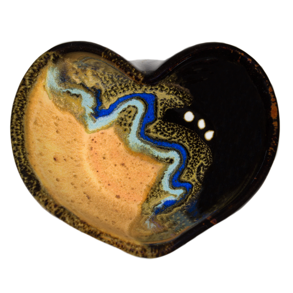 Stoneware heart bowl in yellow and black colors.  Handmade pottery by Prairie Fire Pottery.  Hand made in the U.S.A.  Overhead  view.