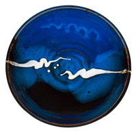 9 inch handmade pottery bowl in cobalt blue and black colors.  Hand made by Prairie Fire Pottery.  Overhead view.