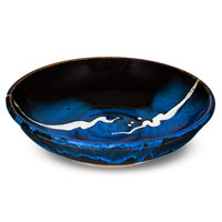 9 inch handmade pottery bowl in cobalt blue and black colors.  Hand made by Prairie Fire Pottery.  3/4 view.