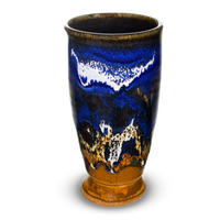 12 oz. handmade pottery tall cup in earth tones and blue, accented with white.  Hand made by Prairie Fire Pottery.