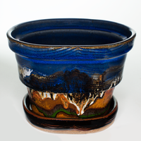 "7"" oval planter in  cobalt blue and toasted orange.  Handmade pottery by Prairie Fire Pottery."