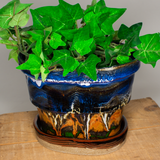 Oval handmade pottery planter with foliage. Blue & brown colors. Hand made pottery by Prairie Fire Pottery.