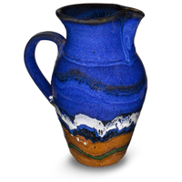 52 ounce wheel-thrown pitcher in cobalt blue and toasted brown.  Handmade pottery by Prairie Fire Pottery.  Hand made in stoneware clay and high-fired to 2400°.  Right side view.