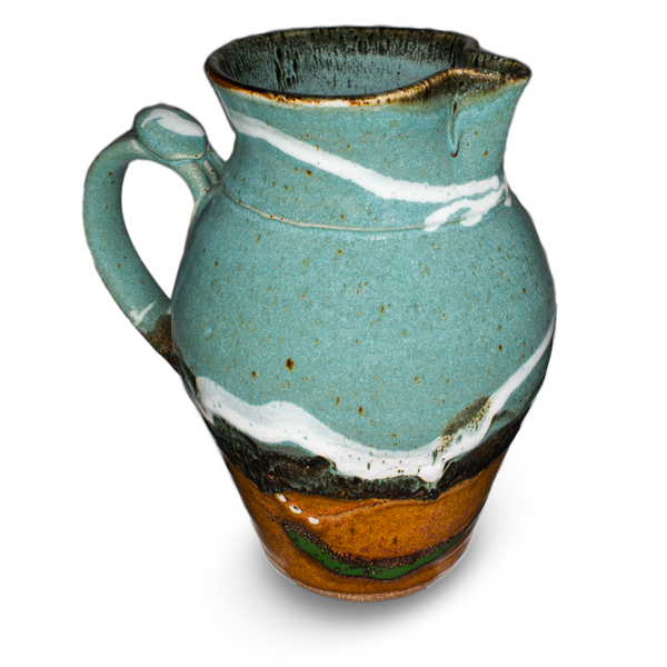 60 ounce wheel-thrown pitcher in turquoise and brown colors.  Handmade pottery crafted in stoneware clay by Prairie Fire Pottery.  Left side view.