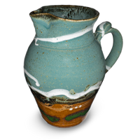 60 ounce wheel-thrown pitcher in turquoise and brown colors.  Handmade pottery crafted in stoneware clay by Prairie Fire Pottery.  Right side view.