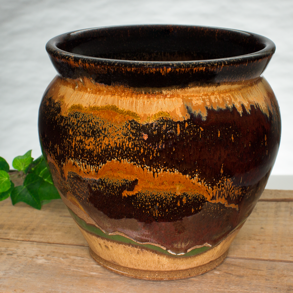 Beautiful toasted orange colors over red on a handmade pottery spoon crock.  Hand made by Prairie Fire Pottery.