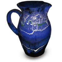 56 ounce handmade pottery pitcher in cobalt blue and black.  Wheel-thrown stoneware clay.  Hand made by Prairie Fire Pottery.  Left side view.