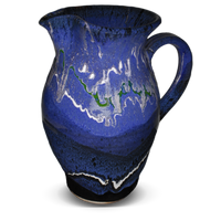 56 ounce handmade pottery pitcher in cobalt blue and black.  Wheel-thrown stoneware clay.  Hand made by Prairie Fire Pottery.  Right side view.