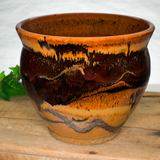6 inch handmade pottery spoon crock in beautiful earth tone colors and red.  Hand made by Prairie Fire Pottery.  Hand crafted and wheel-thrown in stoneware clay.