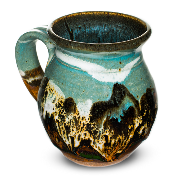 Classic mug with round body style and turquoise and brown glaze colors. Handmade pottery by Prairie Fire Pottery.