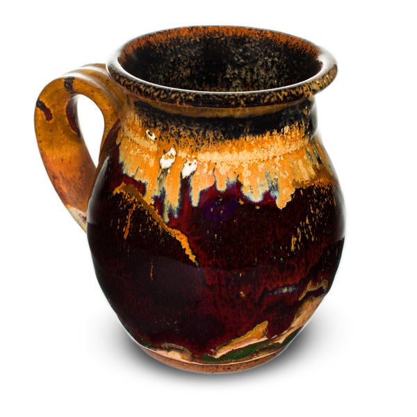 Beautiful 16 oz. handmade pottery mug.  Deep red and earth tone colors.  Hand made by Prairie Fire Pottery in the U.S.A.