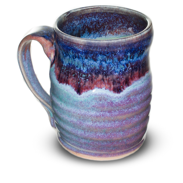 12 oz. handmade pottery mug in beautiful rutile blue that breaks into purple over turquoise.  Hand made stoneware pottery mug.
