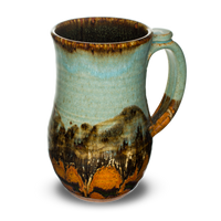 Stoneware mug.  Handmade pottery.  Turquoise-Brown color combination.  Hand made by Prairie Fire Pottery in the U.S.A.  Right side view.