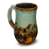 Stoneware mug.  Handmade pottery.  Turquoise-Brown color combination.  Hand made by Prairie Fire Pottery in the U.S.A.  Left side view.