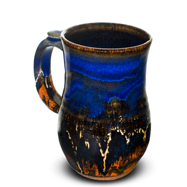 Cobalt blue and toasted orange stoneware mug.  Handmade pottery by Prairie Fire Pottery.  Left side view.