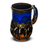 Cobalt blue and toasted orange stoneware mug.  Handmade pottery by Prairie Fire Pottery.  Right side view.