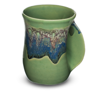 handmade pottery mug with unique handle that allows you to insert your hand.  Misty green color.  Hand made in the U.S.A.