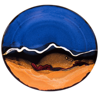 Rich blue over toasted orange colors accented with red.  Handmade pottery serving platter by Prairie Fire Pottery.