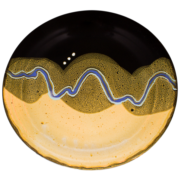 Overhead view of a 14 inch yellow and black serving platter.  It's handmade pottery by Prairie Fire Pottery.  Accented with a meandering blue line.  Hand made in stoneware clay.