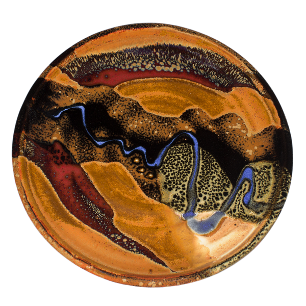 8 inch handmade pottery plate in earth tone colors accented with a meandering blue line.  Hand made in stoneware clay by Prairie Firee Pottery.  Overhead view.
