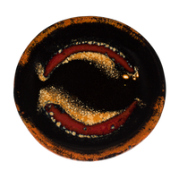 4.5 inch small plate in red and black colors.  Handmade pottery by Prairie Fire Pottery.  Overhead view.