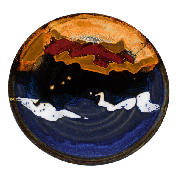 Cobalt blue and toasted brown lunch plate with red accent colors.  Handmade pottery by Prairie Fire Pottery.  Overhead view.