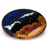 Cobalt blue and toasted brown lunch plate with red accent colors.  Handmade pottery by Prairie Fire Pottery.  3/4 side view.