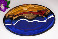 Pretty 9 inch oval plate in cobalt blue, black, and toasted orange.  Handmade pottery by Prairie Fire Pottery.  Stoneware clay.