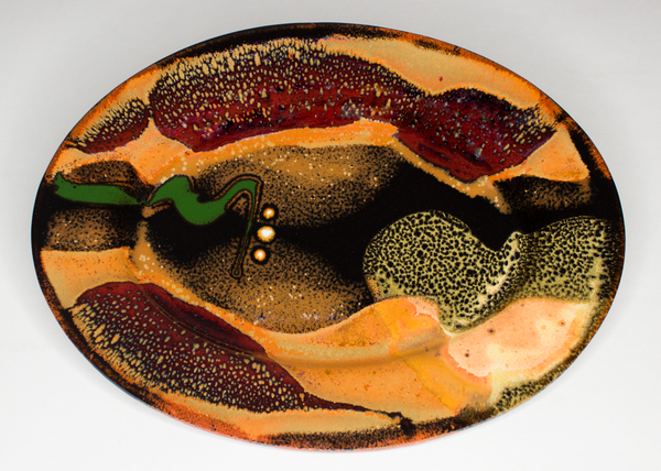 9 inch oval plate in earth tones colors and red. Handmade pottery by Prairie Fire Pottery.