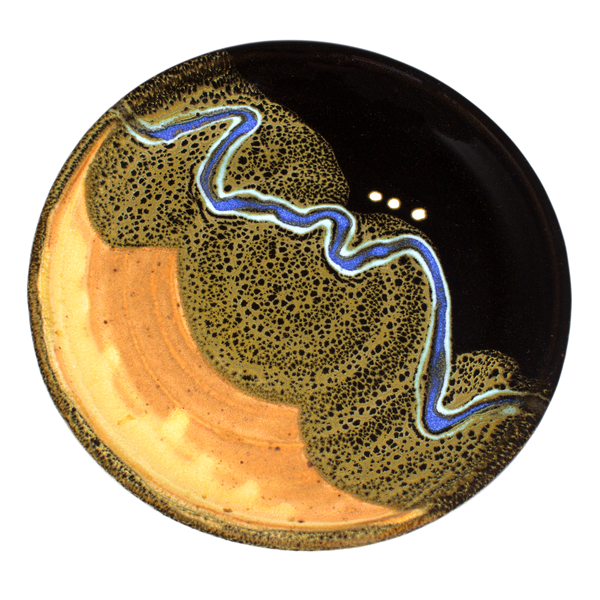 Dry yellow and black lunch plate accented with a meandering ribbon of blue.  Handmade pottery crafted by Prairie Fire Pottery in stoneware clay.  Overhead view.