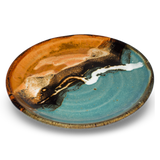 8 inch lunch plate.  Handmade pottery in turquoise-brown colors.  Hand made by Prairie Fire Pottery.  3/4 side view.