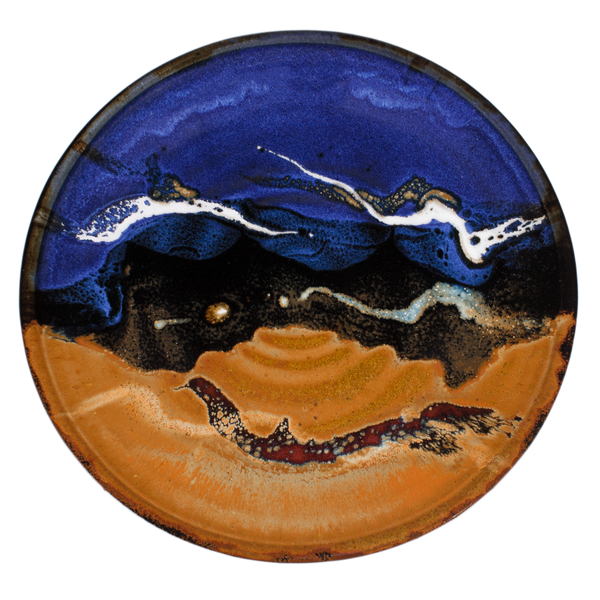 Dinner plate with 10 inch diameter glazed in cobalt blue and toasted brown.  Handmade pottery by Prairie Fire Pottery in stoneware clay.  Hand made in U.S.A.