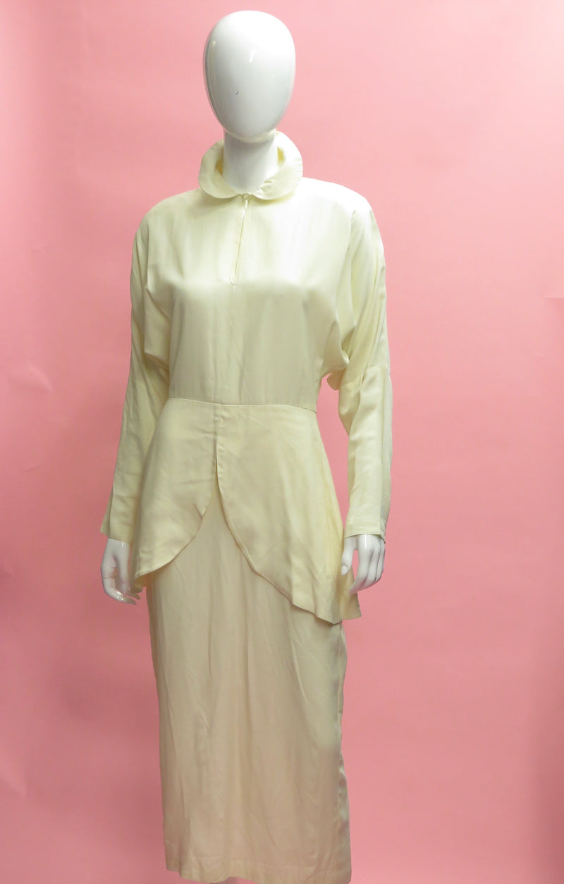 1990's Archive Norma Kamali Dolma sleeve peplum Dress