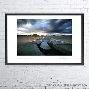 A framed photograph of Swilcan Bridge at St Andrews by Kevin Murray.