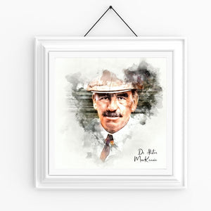 A square hanging framed portrait watercolour of Dr Alister MacKenzie.