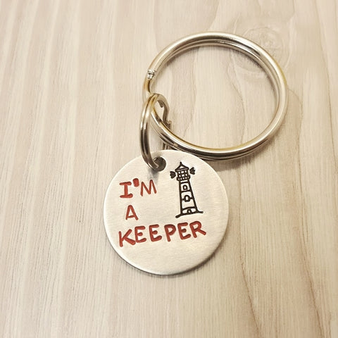"""I'm a Keeper"" Lighthouse Keychain"