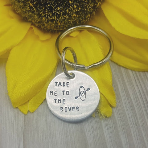 "Hand stamped keychain with ""take me to the water"" Kayaker stamped."