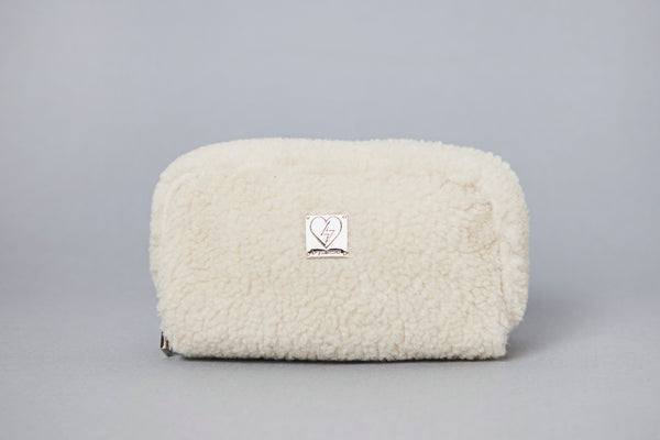 ivory shearling pouch